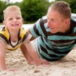 Father and son doing push-ups - Stock Photo