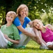 Happy family in the park — Stock Photo #12592665