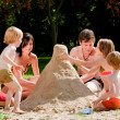 Family is building a big mountain — Stock Photo