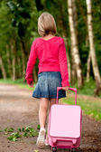 Walking with the suitcase back — Stock Photo