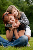 Happy girl with her mom — Stock Photo