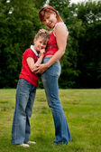 Happy mother and daugther in red — Stock Photo