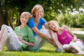 Happy family in the park — Stock Photo