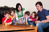 Family is playing an board game — Stock Photo
