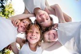 Happy children in white shirts in the sky — Stock Photo