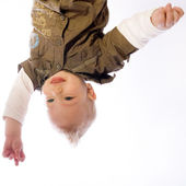 Pretty young baby boy upside down — Stock Photo