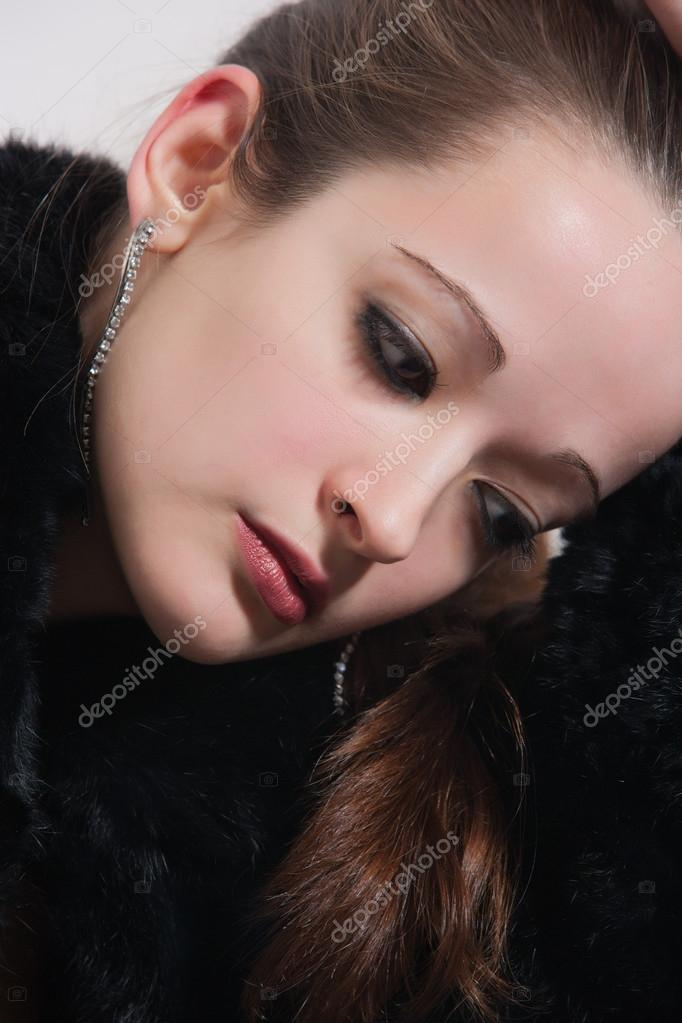 Portrait of a brunette in thoughts — Stock Photo #12593849