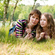 Mother and daugther relaxing in the grass - Foto de Stock  