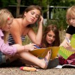 Doing our homework in the park — Stock Photo