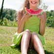 Teenage girl and her watermelon — Stock Photo