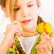 Young girl painting easter eggs — Stock Photo #12608024