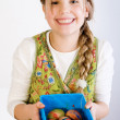 Young girl presenting a box with painted eggs - Photo