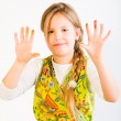 Young girl with paint on hands - Stock Photo
