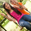 2 girls on the playground - Stock Photo