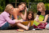 Doing our homework in the park — Stockfoto