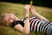 Teenage girl with a flower — Stock Photo