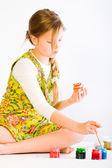 Girl painting easter eggs — Stock Photo