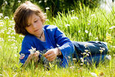 Boy and the flower — Stock Photo