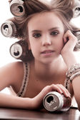 Girl with cans — Stock Photo