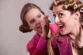 Girls and some curlers — Stock Photo