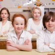 Sitting in the classroom — Stockfoto