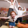 Flying in the classroom — Stock Photo