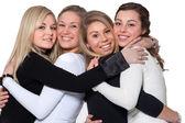Happy 4 woman hug — Stock Photo