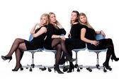 4 ladies on chairs — Stock Photo