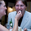 Bride feeding her groom the pie — Stock Photo