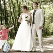 Wedding couple and child — Stock Photo