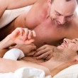 Smiling men couple in bed — Stock Photo #12674625