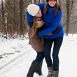 Fighting my sister on a snowy road — Stock Photo