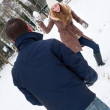 Royalty-Free Stock Photo: Couple having a snowball fight