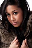 Young beautifull African woman in fur jacket — Foto de Stock
