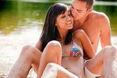 Kiss the bikini babe — Stock Photo