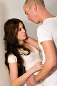 Young couple passionate love against a wall — Stock Photo