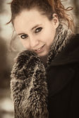 Brownish portrait of beauty in winter coat — Stock Photo