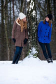 Siters standing against a winter tree — Stock Photo