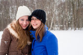 Sisters posing for the camera in winter — Stock Photo