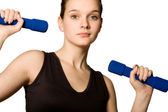 Young girl is holding the weights — Stock Photo