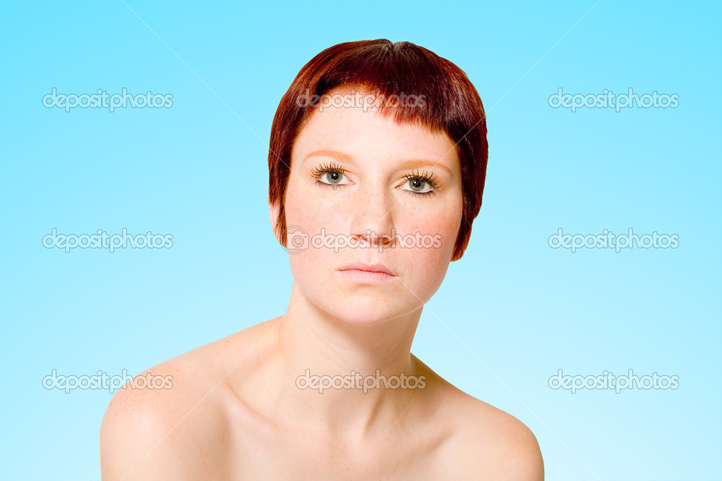 Studio portrait of a young woman with short hair looking neutral — Stock Photo #12695421