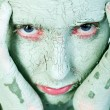Hands on my green clay covered face — Stock Photo #12708729
