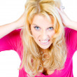 Studio portrait of a hysterical long blond girl — Stock Photo