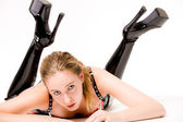 Beautifull blond in laque clothing and high heeled boots — Stock Photo