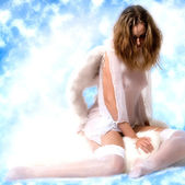 Beautiful angel in the clouds looking down — Stock Photo