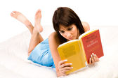 On my belly reading a book — Stock Photo