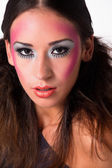 Loving mixed raced girl with extreme make-up — Stock Photo