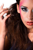 Playing mixed raced girl with extreme make-up — Stock Photo