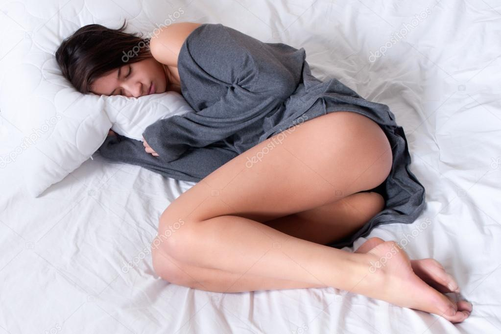 Young mult etnic woman lying and sleeping in bed — Stock Photo #12711461