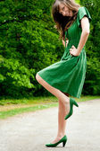 Young fashion green pose — Stock Photo